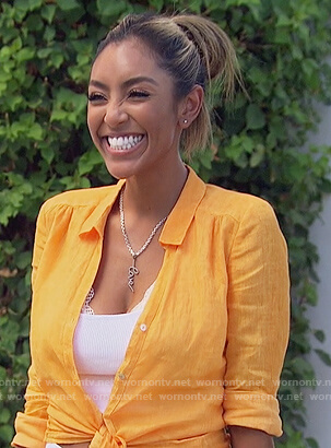 Tayshia's orange linen blouse and white shorts on The Bachelorette
