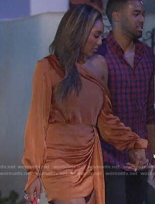 Tayshia's orange satin drape blouse and skirt on The Bachelorette
