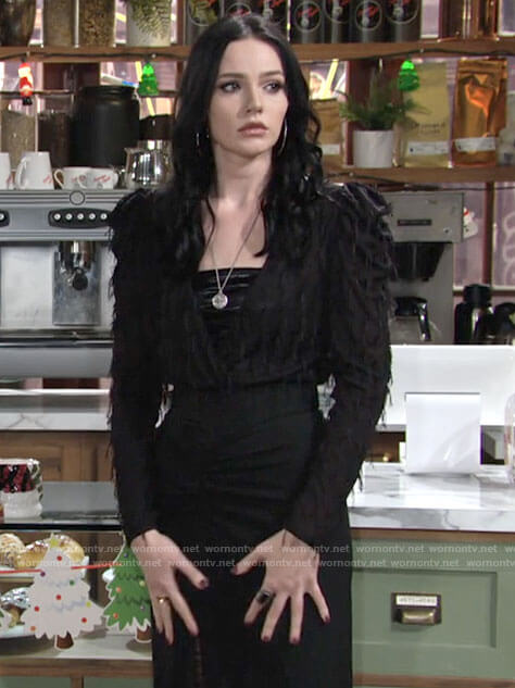 Tessa's black fringed top and ruched skirt on The Young and the Restless