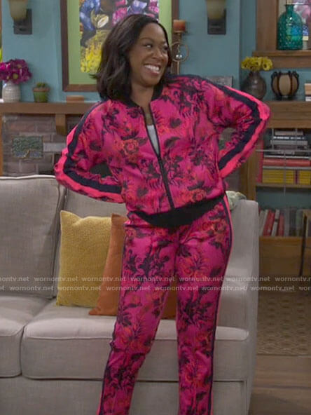 Tina's pink floral track suit on The Neighborhood