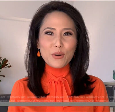 Vicky's orange tie neck knit top on Today
