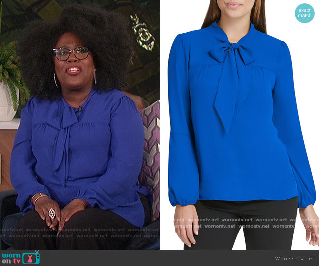 Long Puff Sleeve Tie Neck Blouse by DKNY worn by Sheryl Underwood  on The Talk