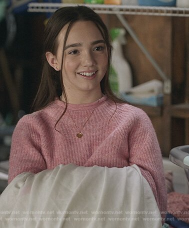 Grace's pink mock neck sweater on The Unicorn