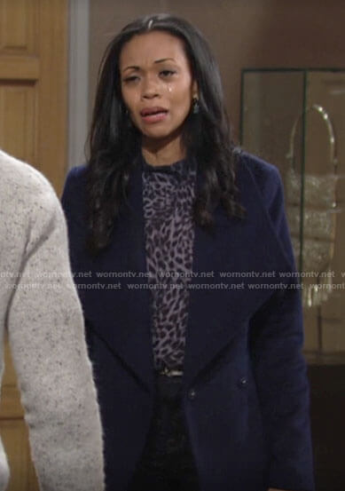 Amanda's blue leopard print blouse and navy coat on The Young and the Restless