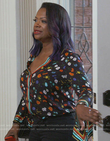 Kandi's black floral blouse on The Real Housewives of Atlanta