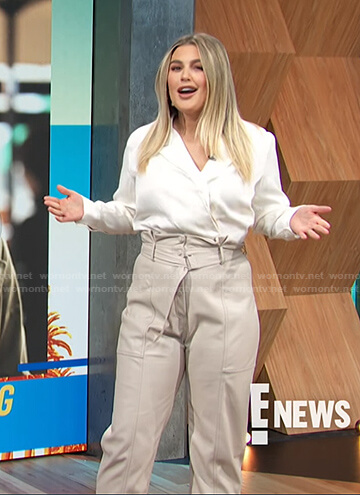 Carissa's white blouse and leather belted pants on E! News Daily Pop