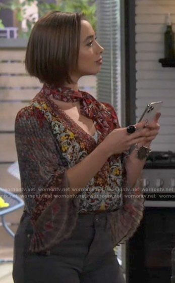 Celia's printed tie-neck blouse with pleated sleeves on Call Your Mother