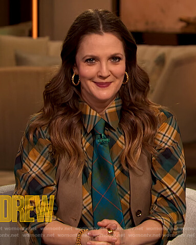 Drew's green plaid blouse and leather skirt on The Drew Barrymore Show