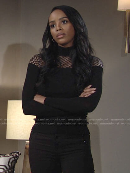 Imani's black eyelet sweater and button detail jeans on The Young and the Restless
