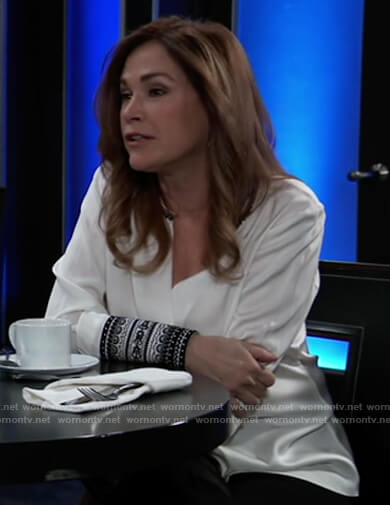 Jackie's white blouse with embroidered cuffs on General Hospital