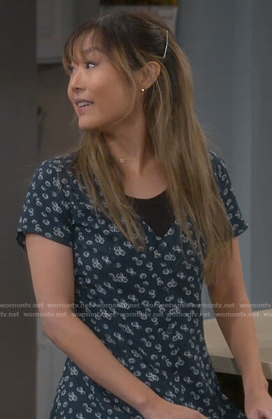 Jen's green daisy print button front dress on Last Man Standing