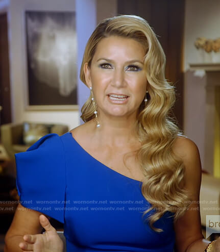 Kary's blue one-shoulder top on The Real Housewives of Dallas