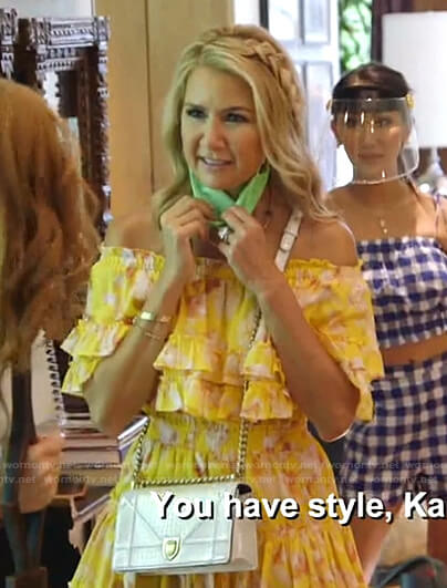 Kary's yellow floral ruffle off-shoulder dress on The Real Housewives of Dallas