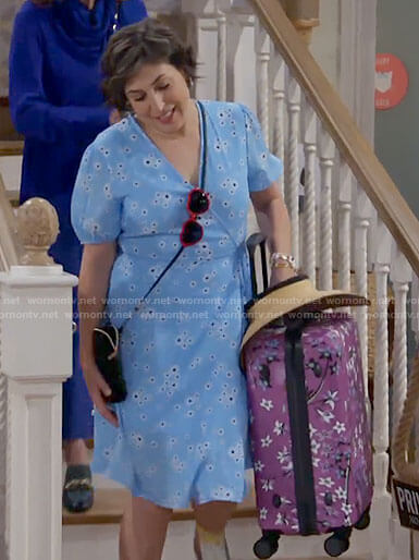 Kat's blue floral wrap dress and purple suitcase on Call Me Kat