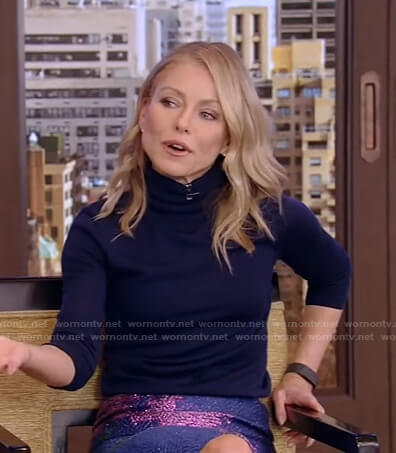 Kelly's navy turtleneck sweater and floral skirt on Live with Kelly and Ryan