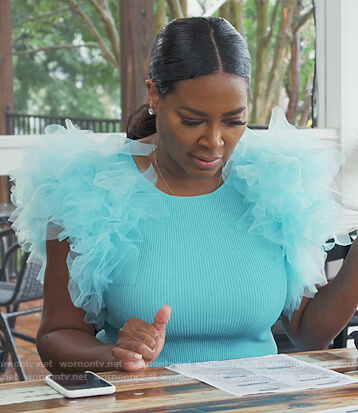 Kenya's turquoise ruffle shoulder top on The Real Housewives of Atlanta