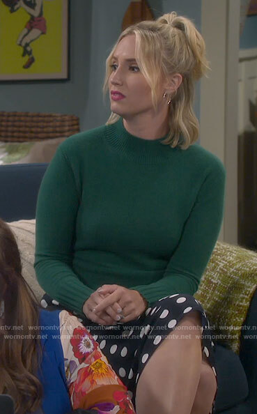 Mandy's green sweater and polka dot skirt on Last Man Standing