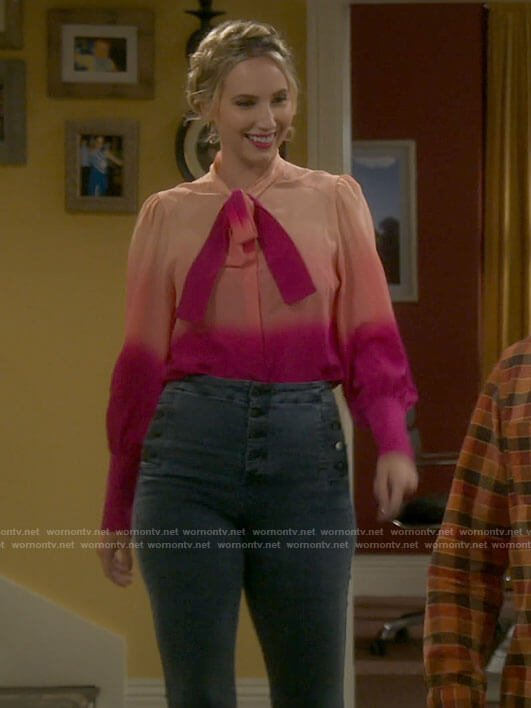 Mandy's pink ombre tie neck blouse and grey jeans on Last Man Standing