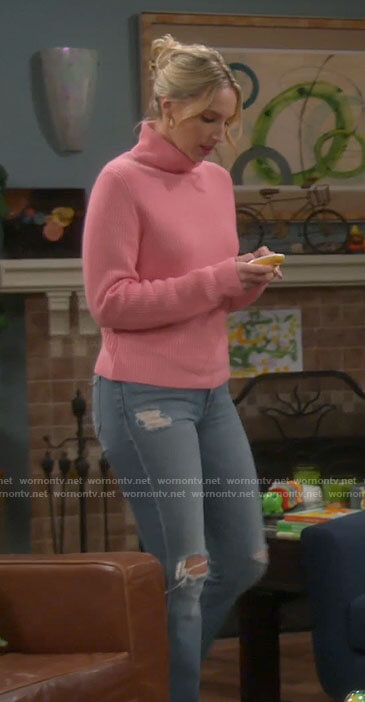 Mandy's pink turtleneck and distressed jeans on Last Man Standing