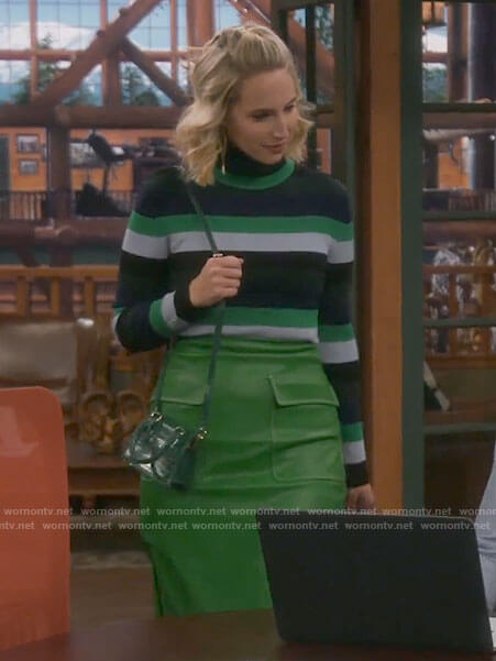 Mandy's striped turtleneck and green leather skirt on Last Man Standing