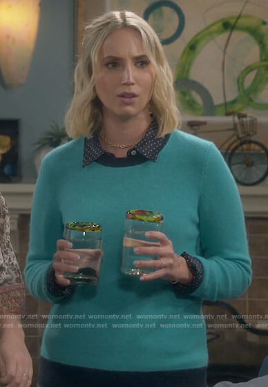 Mandy's turquoise sweater with navy trim on Last Man Standing