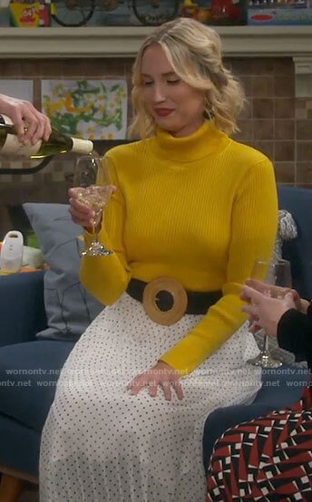 Mandy's yellow turtleneck and white pleated polka dot skirt on Last Man Standing