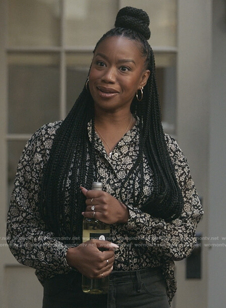 Michelle's black floral print blouse on The Unicorn