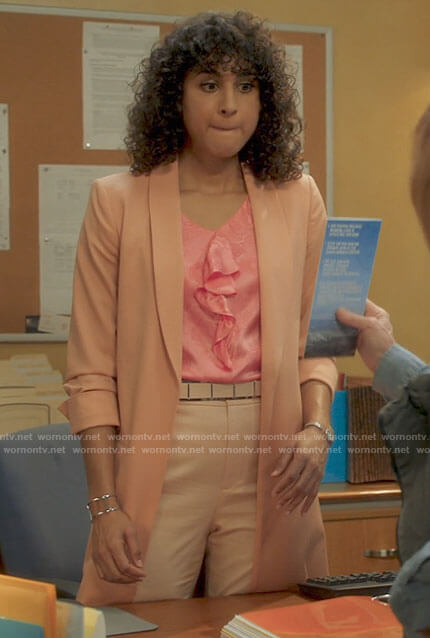 Mikaela's pink ruffled front top and long coral jacket on Mr Mayor
