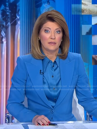 Norah's blue satin shirt and peak lapel blazer on CBS Evening News