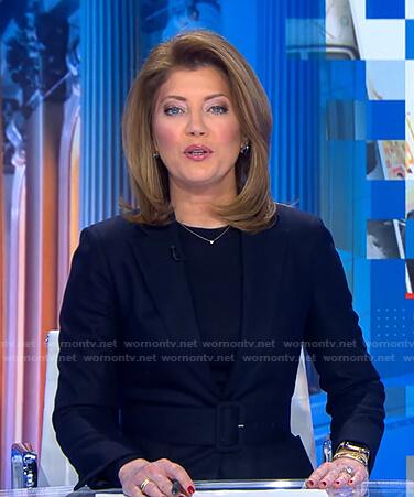 Norah's navy belted blazer on CBS Evening News