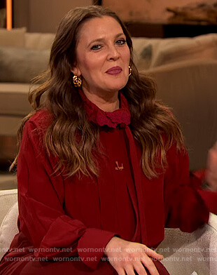 Drew's red tie neck blouse on The Drew Barrymore Show