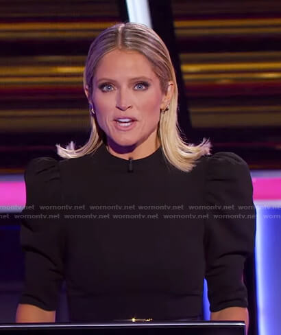 Sara's black puff sleeve jumpsuit on The Chase