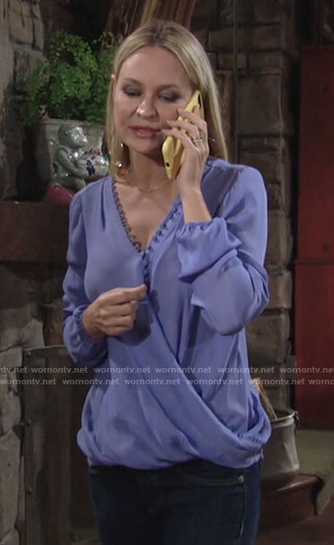 Sharon's blue wrap front blouse with button detail on The Young and the Restless