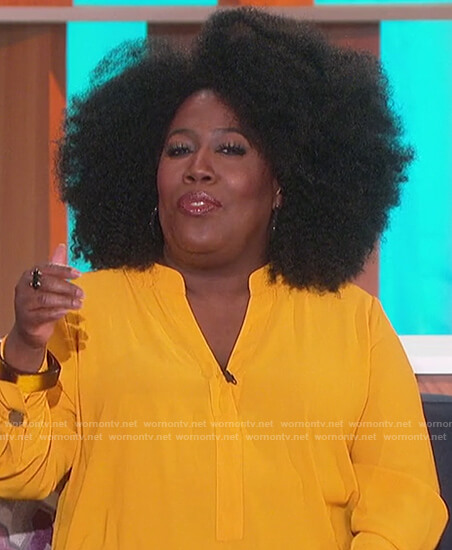Sheryl's yellow v-neck top on The Talk
