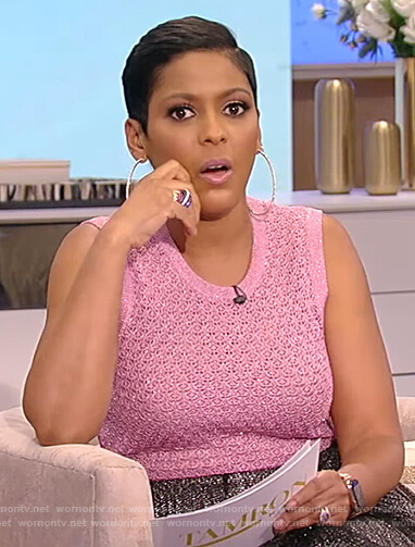 Tamron's pink metallic knit top and pleated skirt on Tamron Hall Show