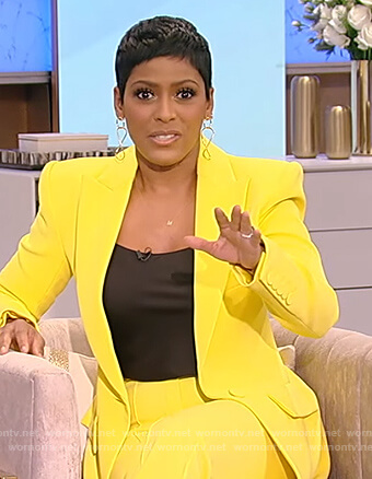 Tamron's yellow blazer and pants on Tamron Hall Show