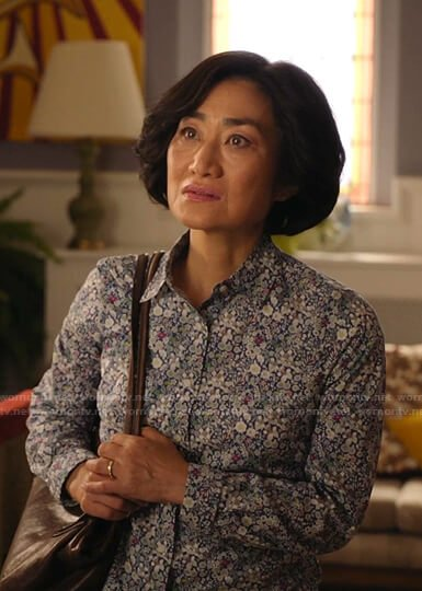 Janet's white floral lace-trim top on Kims Convenience