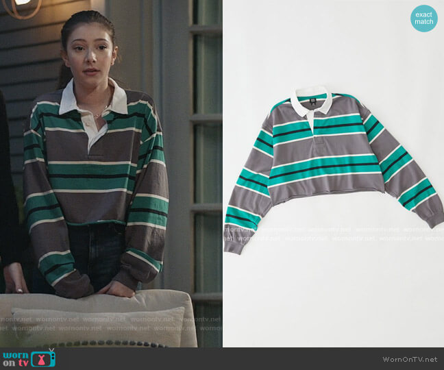 Jefferson Cropped Rugby Shirt by Urban Outfitters worn by Natalie (Makenzie Moss) on The Unicorn