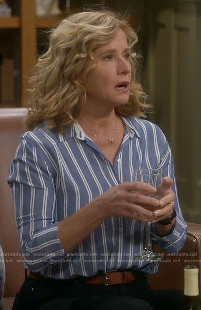 Vanessa's blue striped button down shirt on Last Man Standing