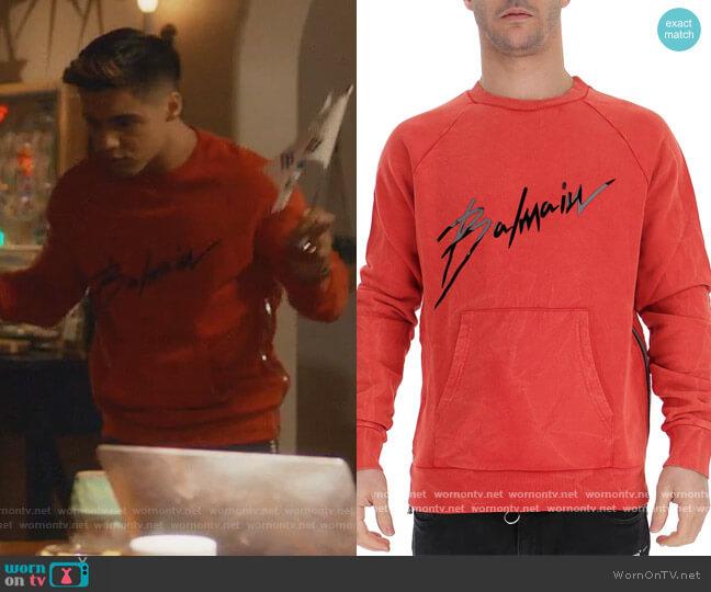Balmain Signature Logo Sweatshirt by Balmain worn by Vivek Shah (Jordan Buhat) on Grown-ish