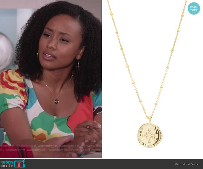 Compass Coin Pendant Necklace by Gorjana worn by Katlyn Nichol on Black-ish worn by Olivia Lockhart (Katlyn Nichol) on Blackish
