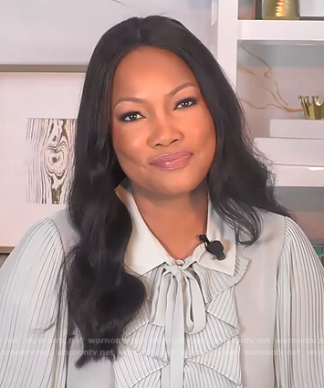 Garcelle's mint ruffle front blouse on The Real