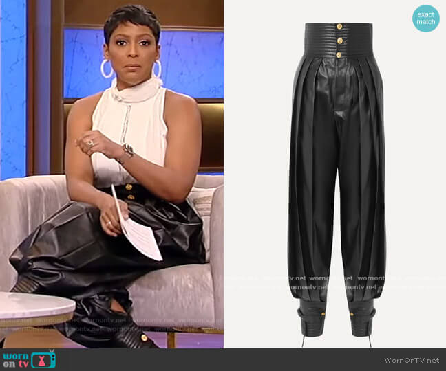 Pleated leather tapered pants by Gucci worn by Tamron Hall  on Tamron Hall Show