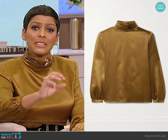 Silk-satin blouse by Saint Laurent worn by Tamron Hall  on Tamron Hall Show