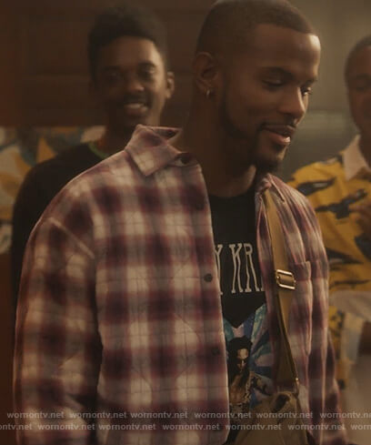 Aaron's plaid shirt and Lenny Kravitz graphic tee on Grown-ish