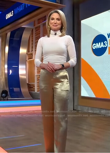 Amy's white turtleneck top and metallic gold pants on Good Morning America