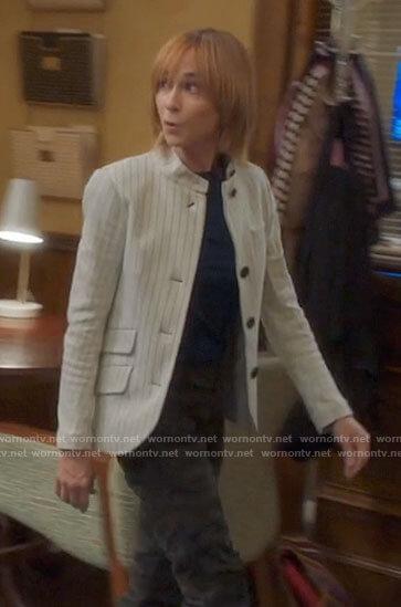 Arpi's white pinstriped jacket on Mr Mayor