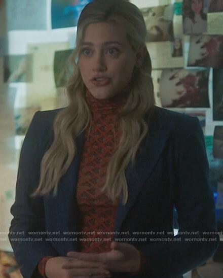 Betty's orange printed turtleneck top and blue blazer on Riverdale