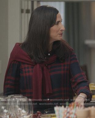 Delia's navy plaid shirt on The Unicorn