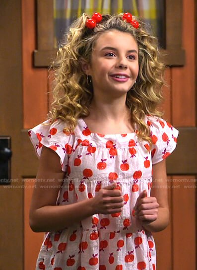 Destiny's pink apple print top on Bunkd